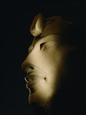 A Statue of Akhenaten Lost in Shadow by Kenneth Garrett
