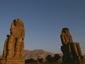 A View of the Crumbling Colossi of Memnon by Kenneth Garrett
