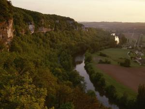 A View of the Vezere River Valley and the Cliffs of Les Eyzies by Kenneth Garrett