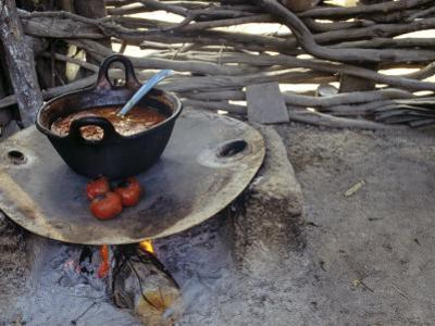 Beans and Tomoatoes Cook over a Fiel, Yucatan, Mexico by Kenneth Garrett