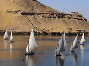 Feluccas on the Nile Sail Past the Tombs of Qubbat Al Hawa at Aswan by Kenneth Garrett