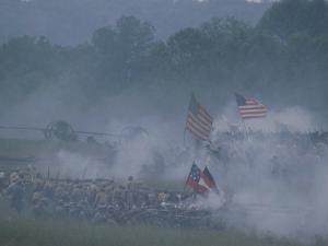 Flags, Soldiers, and Gun Smoke During a Civil War Reenactment by Kenneth Garrett