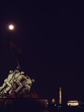 Night View of the Iwo Jima Monument under a Full Moon by Kenneth Garrett
