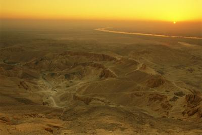 Sunrise over the Valley of the Kings in the Western Desert. by Kenneth Garrett
