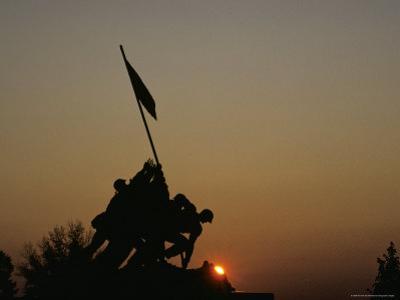 The Iwo Jima Memorial Silhouetted by a Setting Sun, Washington, D.C. by Kenneth Garrett
