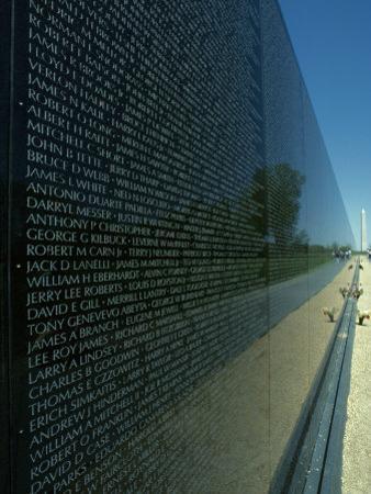 Vietnam Memorial with Washington Monument in Background, Washington, D.C. by Kenneth Garrett