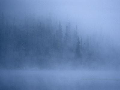 Morning Mist Rises Off a Lake in Algonquin Park in Central Ontario by Kenneth Ginn