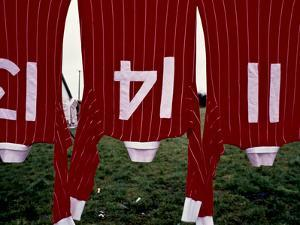 Soccer Sweaters on a Clothes Line by Kenneth Ginn