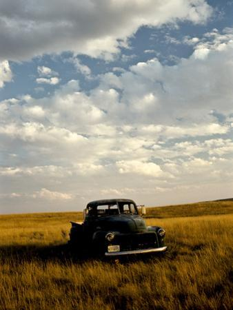Sunset View of an Old Farm Truck by Kenneth Ginn