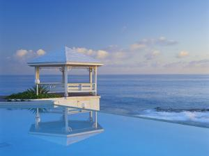 Gazebo Reflecting on Pool with Sea in Background, Long Island, Bahamas by Kent Foster