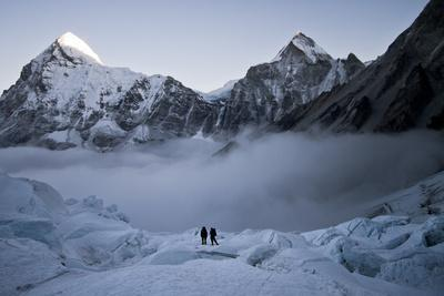Climbers Navigate the Khumbu Icefall with Pumori and Lingtrin in the Background in Nepal
