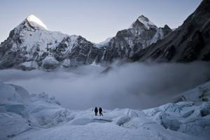 Climbers Navigate the Khumbu Icefall with Pumori and Lingtrin in the Background in Nepal by Kent Harvey