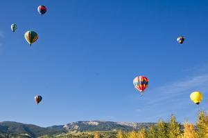 Hot Air Balloons Rise Above Aspen Groves in Snowmass Village, Colorado by Kent Harvey