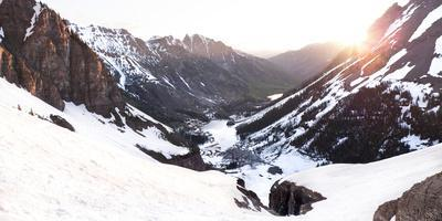 Sunrise over the West Maroon Valley in the Maroon Bells Wilderness, Colorado