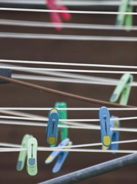 Colorful Clothespins on a Clothesline by Kent Kobersteen