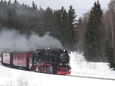 Meter-Gauge 2-10-2T Steam Locomotive 99 7241-5 in a Snowy Landscape