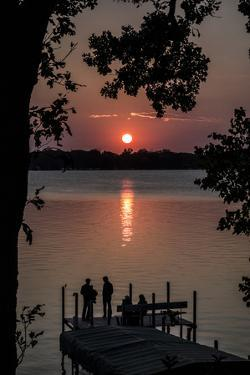 Residents Watch a Late Summer Sunset from their Dock on West Okoboji Lake by Kent Kobersteen