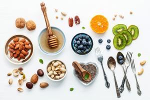 Ingredients for A Healthy Foods Background, Nuts, Honey, Berries, Fruits, Blueberry, Orange, Almond by Kerdkanno