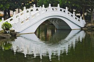 Bridge over garden pond in Liberty Square, Taipei, Taiwan by Keren Su