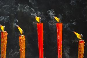 Candle burning at temple, Hanshan, Xinshi, Zhejiang Province, China by Keren Su
