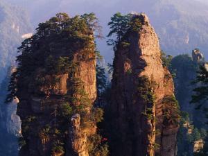 China, Hunan Province, Zhangjiajie National Forest Park, Pillars at Sunset by Keren Su