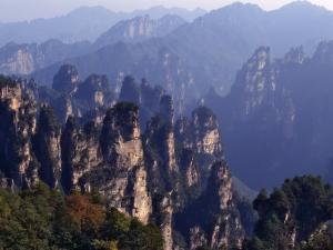China, Hunan Province, Zhangjiajie National Forest Park, Pillars Rising from Forest by Keren Su