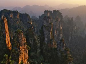 China, Hunan Province, Zhangjiajie National Forest Park, Pillars Rising from Forest by Keren Su
