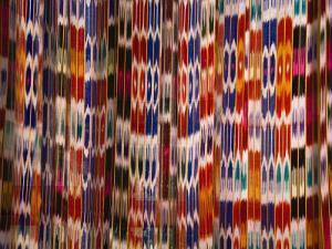China, Silk Road, Xinjiang Province, Hotan, Carpet with Colorful Atalas Pattern by Keren Su