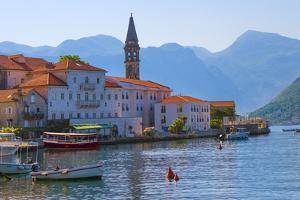 Church tower and houses on the Adriatic coast, Perast, Montenegro by Keren Su