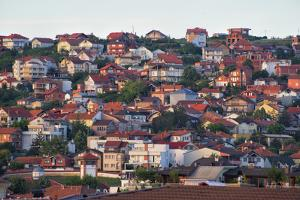 Cityscape of red roof houses, Pristina, Kosovo by Keren Su