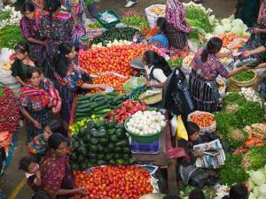 Colorful Vegetable Market in Chichicastenango, Guatemala by Keren Su