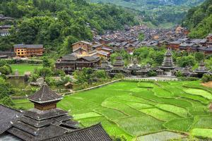 Dong village and rice paddy in the mountain, Zhaoxing, Guizhou Province, China by Keren Su