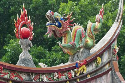 Dragon sculpture on the roof of a temple, Xiamen, Fujian Province, China by Keren Su