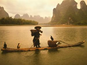 Fisherman in Bamboo Raft on the Li River, China by Keren Su
