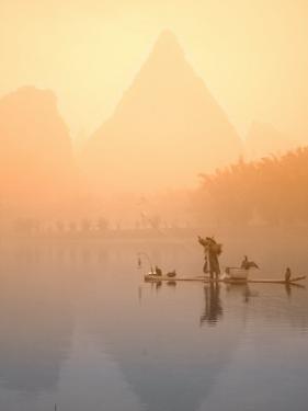 Fisherman on Bamboo Raft in Early Morning Mist, Li River, China by Keren Su
