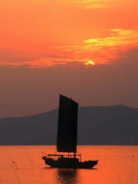 Fishing Boat Sailing Across Lake Taihu at Sunset, Wuxi, China by Keren Su