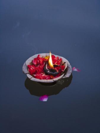 Flower Lamp on the Ganges River, Varanasi, India by Keren Su