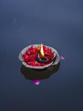 Flower Lamp on the Ganges River, Varanasi, India by Keren Su