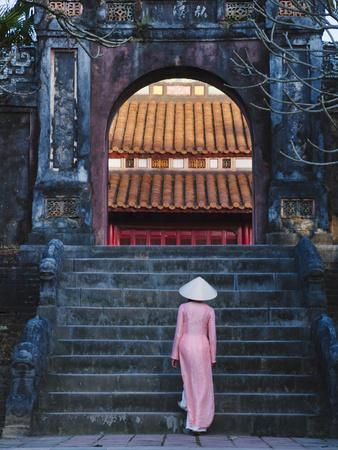 Girl in Ao Dai (Traditional Vietnamese Long Dress) and Conical Hat at Minh Mang Tomb, Vietnam