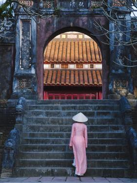 Girl in Ao Dai (Traditional Vietnamese Long Dress) and Conical Hat at Minh Mang Tomb, Vietnam by Keren Su
