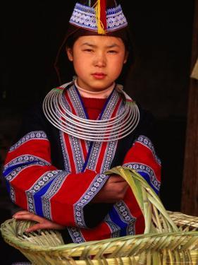 Girl in Traditional Dress Carrying Basket, Anshun, China by Keren Su