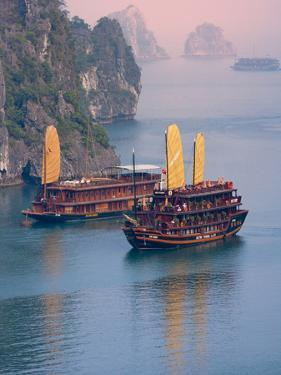 Junk Boat and Karst Islands in Halong Bay, Vietnam by Keren Su