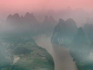 Karst Hills with Li River in Early Morning Mist, China by Keren Su