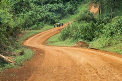 Local people traveling on dirt road, west Uganda by Keren Su