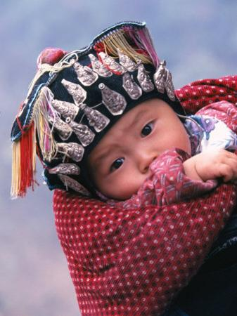 Miao Baby Wearing Traditional Hat, China by Keren Su