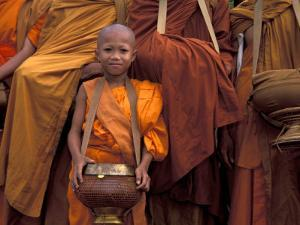 Monk with Alms Wok at That Luang Festival, Laos by Keren Su