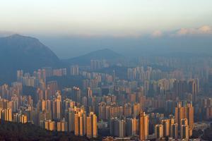 Morning view of high-rise, Hong Kong, China by Keren Su