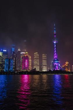 Night view of high-rises by Huangpu River, Pudong, Shanghai, China by Keren Su