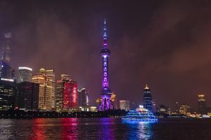 Night view of Oriental Pearl TV Tower and high-rises by Huangpu River, Pudong, Shanghai, China by Keren Su