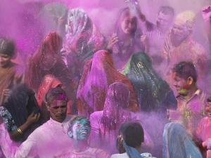 People Throwing Color Powder and Water on Street, Holy Festival, Barsana, India by Keren Su